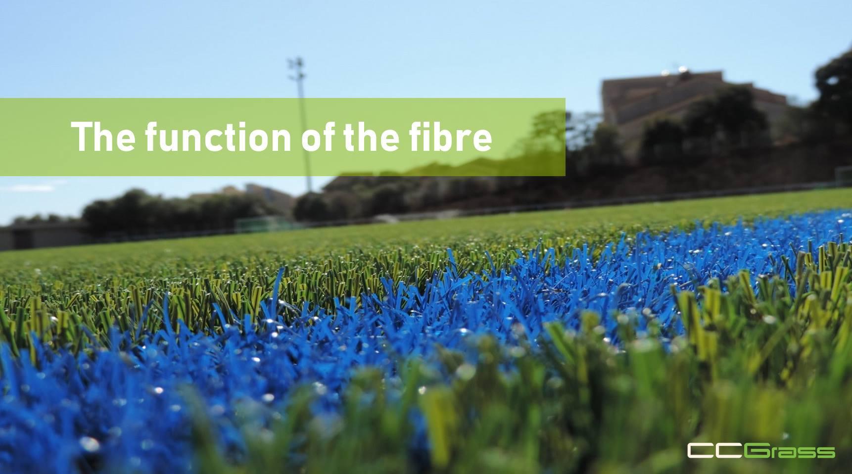 How do the artificial grass fibers play different functions