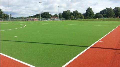 Artificial grass for hockey fields