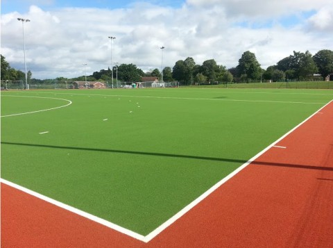 Artificial grass for hockey fields
